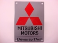 Mitsubishi Motors Driven to Thrill 10 x14 cm Emaille